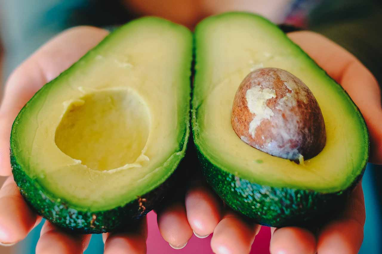 Eating for beauty - Laura's Idea - avocado in hands